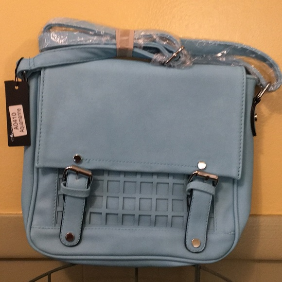 Moda International Handbags - Colorful aquamarine MODA crossbody purse.